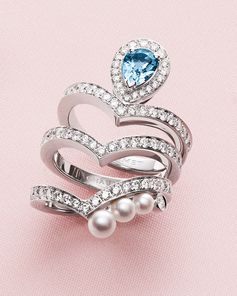 Three stackable Joséphine Aigrette rings: white gold with brilliant-cut diamonds and a pear-shaped aquamarine, white gold with brilliant-cut diamonds and white gold with brilliant-cut diamonds and Akoya-cultured pearls.