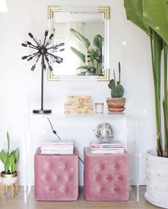 You can't go wrong with pink and plants. Find a mix of modern pieces right at your Home Goods. Acrylic furniture can help keep a small space feeling open and airy. A disco ball doesn't hurt either. (Sponsored pin)