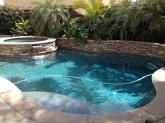 Perfect pool for a small backyard. Dimensions are about 18' by 26' including spa.