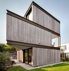 A modern house with an exterior of wood, metal, and glass.