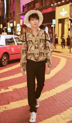 Actor Wu Lei wears a Henry Moore-inspired Burberry Framed Heads print shirt in Hong Kong