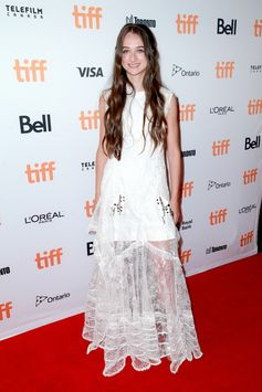 """Raffey Cassidy wearing a Louis Vuitton Cruise 2018 lace dress and sandals to the """"The killing of a Sacred Deer"""" premiere during the Toronto Film Festival, Canada."""