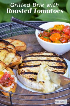 Grilled Brie with Roasted Cherry Tomatoes - This appetizer is deceptively easy to make. You can roast the tomatoes in the air fryer, oven or grill. Then, grill the Brie cheese gently and put the whole plate together. Simple AND it will get everyone's attention. Just cut into the warm Brie wheel, serve with bread and tomatoes and let people go to town. #bluejeanchef #brie #grilledappetizers