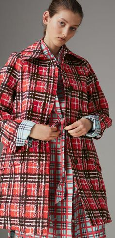 A clean-lined car coat in bonded cotton defaced with a marker-pen check print from Burberry.