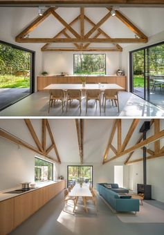 Inside this modern house, the minimalist kitchen, dining area, and living room all share the same space, while the roof structure has been left exposed. #OpenPlanInterior #MinimalistKitchen #DiningRoom #ExposedCeiling #LivingRoom #Fireplace