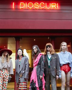 Before walking the Gucci Spring Summer 2019 fashion show, a line-up of women's and men's looks by Alessandro Michele appear in front of the Théâtre Le Palace, its façade decorated with the neon sign 'I Dioscuri' for the runway presentation.