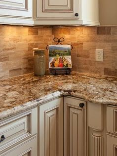 Traditional Tuscan Kitchen Makeover | HGTV travertine granite and ivory cabinets