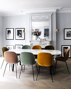 Sleek and alluring dinner table setting in the chic Paris apartment of @mrs.lappartement featuring velvet Beetle Chairs in a vibrant mix of colours. #gubi #gubiofficial #beetlechair #gamfratesi