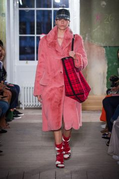 A pink tailored coat reimagined in soft faux fur detailed with prim notch lapels is styled with The Giant red tartan tote. Complete with Argyle knitted socks and tartan high-heel sandals.