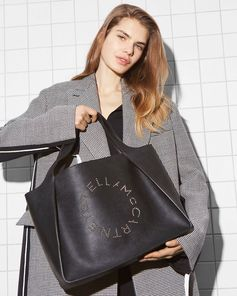 Crafted from smooth alter-nappa the logo tote comes in a minimalist monochrome update for the new season.