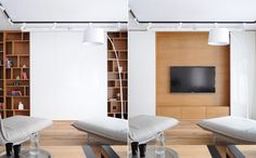 A TV is hidden behind sliding white wall panels in a living room.
