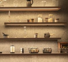 These modern floating wood shelves, which are all different lengths, have a strip of hidden lighting underneath, highlighting the various displayed items, as well as adding ambient lighting and a dramatic touch to the kitchen. #KitchenShelves #Shelving #Shelves #FloatingShelves #HiddenLighting