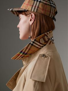 First seen at the #Burberry show, our relaxed-fit trench coat revised with a Rainbow Vintage check lining and undercollar