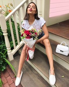Simply happy: Olivia Culpo with her white #TodsGommino. #OliviaCulpo