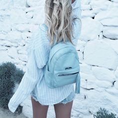 Claire Chanelle, in vacation mood, wearing the blue backpack from the Twist Together collection (July 2016).   this baby blue backpack matches perfectly your vacation mood!