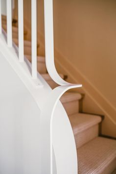 A curved and modern stair handrail.