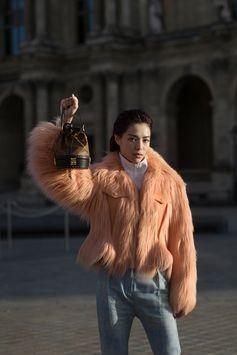 Zhong Xu Chi wearing a full Louis Vuitton look from the Fall-Winter 2017 Collection, attending the Louis Vuitton Spring-Summer 2018 Fashion Show at Musée du Louvre, Paris.