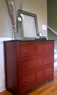 Annie Sloan chalk paint Primer Red. I'm currently painting my hutch with this paint..very cool stuff!