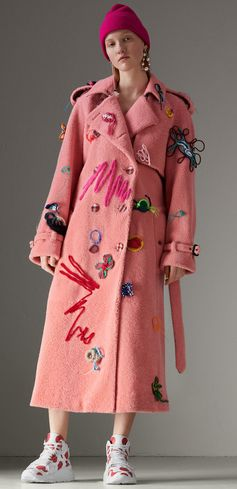 The iconic trench remade in fuzzy pink shearling with handmade crocheted flowers, art-and-craft swirls and epaulette-inspired braiding. First seen on the #Burberry runway