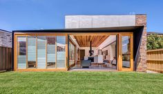 Oversized Sliding Doors On This House Connect The Living Room With The Back Yard And An Outdoor Room