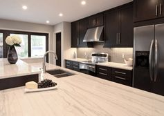 contemporary kitchen design with espresso stained kitchen cabinets & kitchen island, white stone counter tops, gray glass tiles backsplash