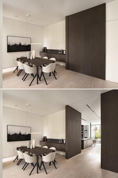 A modern dining room with a large sliding wood door.