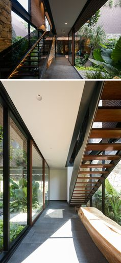 Wood, steel and glass stairs lead to the upper floor of this modern Mexican house.