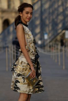 Annie Chen wearing a dress from the Louis Vuitton Cruise 2018 Collection, attending the Louis Vuitton Spring-Summer 2018 Fashion Show at Musée du Louvre, Paris.