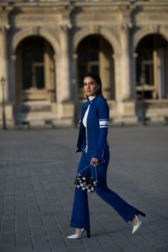 Camila Coelho wearing a Louis Vuitton outfit from the Fall-Winter 2017 Collection, attending the Louis Vuitton Spring-Summer 2018 Fashion Show at Musée du Louvre, Paris.