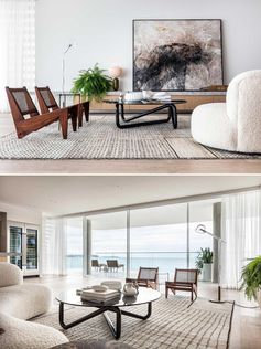 A large rug anchors this living room, while a low cabinet provides a place to display artwork, plants, and decor, and a curved sofa keeps things casual.