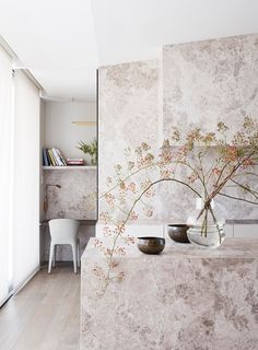 Stone used in the kitchen carries through to a small desk area.