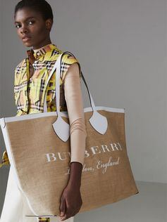 A supersized #Burberry tote updated in jute with printed Burberry lettering, framed with sealed seams