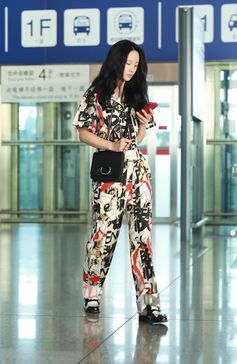 Actress Vivien Li wearing #Burberry Graffiti Archive Scarf Print Jumpsuit with the D-ring Bag at Beijing airport
