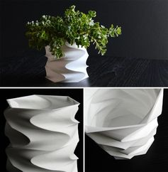 A modern and sculptural succulent pot made from 3d printed plastic.