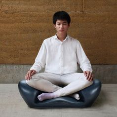 A meditation seat that allows the user to sit cross-legged comfortably.