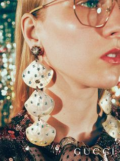 Seen in the Gucci Gift 2018 campaing, new earrings crafted from natural mother of pearl are dotted with star-cut crystals.