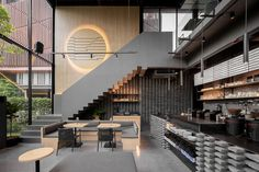 A Material Palette Of Warm Woods And Grey Elements Has Been Used To Create This Contemporary Coffee Shop Interior