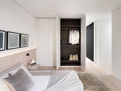 Bedroom with lighting wood headboard and hidden lighting.