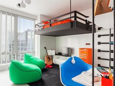 A loft bed creates open floor space for this teen's bedroom.