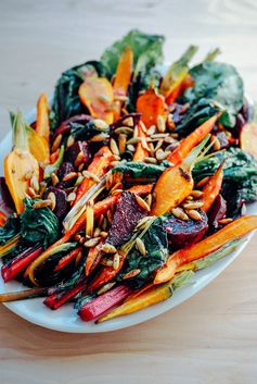 This Roasted Vegetable Salad with Garlic Dressing and Toasted Pepitas is full of flavor and takes 30 minutes to prepare.