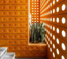 Custom designed modern bricks with small round windows and circular indents were used to create a buildling in Tehran.