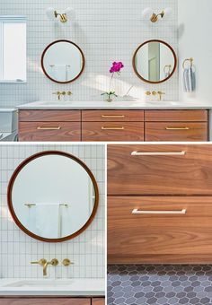 A modern bathroom with a wood vanity, gold accents, white tiles, and round mirrors.