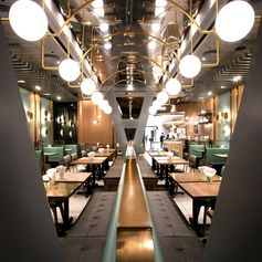 A modern restaurant with banquette seating. #Restaurant #BanquetteSeating