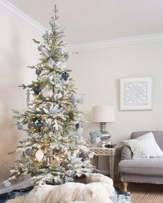Add the splendor of winter woodlands to your living room with our Frosted Alpine Balsam Fir. This artificial Christmas tree is sparse by design for a more natural look. The tree's light-green True Needle™ foliage is heavily flocked to mimic the appearance of beautiful snow-covered branches.