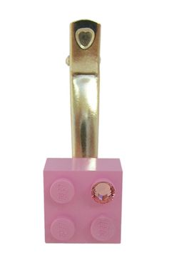 Light Pink LEGO® brick 2x2 with a Pink SWAROVSKI® crystal on a Silver/Gold hair clip (one piece)* Selected and rare color of the LEGO® brick * If you have a preference for the metal of the hair clip, dont forget to clarify it. REMINDER LEGO® is a trademark of the LEGO Group which does not