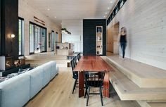 The Floor Turns Into Built-In Bench Seating In This Split Level Interior