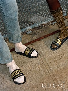 Leather slippers from Gucci-Dapper Dan collection, printed with gold lettering.