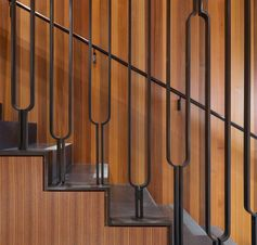 This modern black steel balustrade has a u-shaped design, adding an artistic touch to the home. #Stairs #StairDesign #SteelStairs #Handrail #SteelHandrail