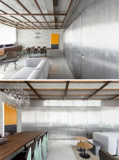 This modern apartment features a perforated stainless steel sheet panel wall that hides all of the apartment doors that lead to the kitchen, bedroom and bathroom. #StainlessSteelWall #ApartmentDesign #ApartmentInterior #HiddenDoors