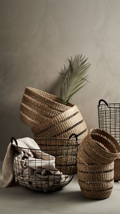 H&M HOME | Store in style with these rustic woven and classic metal baskets.